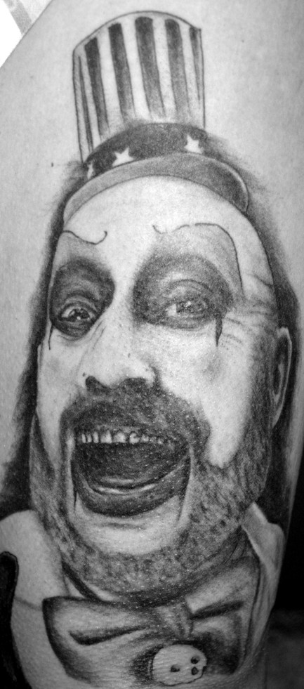 Captain Spaulding thigh tattoo